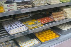 Assortment of traditional Indian sweets. Sweet shop showcase displaying an assortment of traditional Indian sweets. Among them Gulab Jamun, Jaleebi, Ladoo royalty free stock image