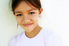Sweet shy girl. Portrait of a beautiful smiling ten year old girl with enough copy space. Fit for innocence, fresh faces, young world, world vision, my world Stock Photography