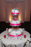 Sweet Sixteen cake. Three tier, formal cake for sweet sixteen/quince. White with pink ribbons Royalty Free Stock Images