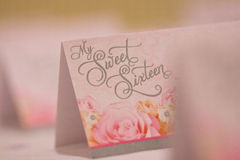 Sweet Sixteen cards. Close up of My sweet sixteen pink table placecards, party details Stock Photo