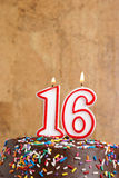 Sweet Sixteen. A number candle represents sixteen sweet years worth celebrating Stock Image