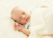 Sweet sleep infant on the bed Stock Image