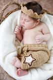 Sweet sleeping newborn baby in wicker basket-collage Stock Photos