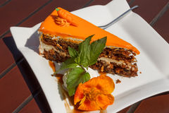Sweet slice of carrot cake on a white plate Stock Images