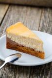 Sweet slice of carrot cake on white plate. Stock Photos