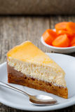 Sweet slice of carrot cake on white plate. Royalty Free Stock Image