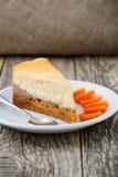Sweet slice of carrot cake on white plate. Stock Image
