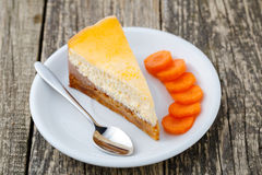 Sweet slice of carrot cake on white plate. Stock Images