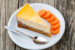 Sweet slice of carrot cake on white plate. Stock Photo