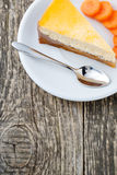 Sweet slice of carrot cake on white plate. Stock Image