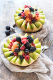 Sweet sliced melons stuffed with berry fruit Stock Photography