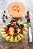Sweet sliced melons stuffed with berry fruit Stock Images