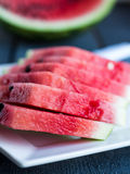 Sweet slices of watermelon  on a dark wooden background. Juicy, sweet slices of watermelon  on a dark wooden background Stock Photos