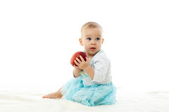 Sweet small baby with apple. Royalty Free Stock Photos