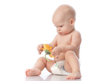 Sweet small baby with flower. Royalty Free Stock Photos