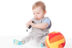 Sweet small baby with mobile phone. Royalty Free Stock Photography