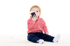 Sweet small baby with mobile phone. Royalty Free Stock Image