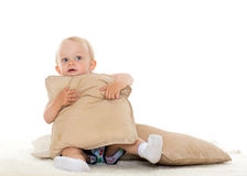 Sweet small baby with pillows. Stock Photography