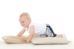 Sweet small baby with pillows. Stock Image