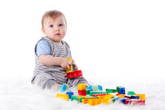 Sweet small baby with toy. Stock Images
