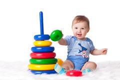 Sweet small baby with toy. Stock Photography