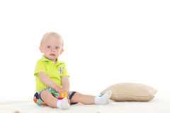 Sweet small baby with toy. Stock Photo