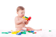 Sweet small baby with toys. Stock Photo