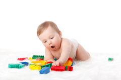 Sweet small baby with toys. Royalty Free Stock Photography