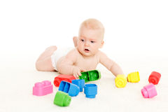 Sweet small baby with toys. Royalty Free Stock Image