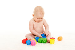 Sweet small baby with toys. Royalty Free Stock Photos