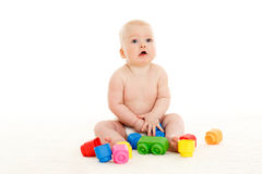 Sweet small baby with toys. Royalty Free Stock Images