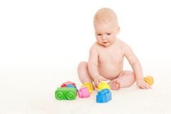 Sweet small baby with toys. Stock Photos