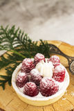 Sweet small tarts with fresh raspberry. Sweet small french tarts with fresh raspberry and cream. Selective focus Royalty Free Stock Photo