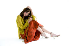 Sweet smile. Sweet youth smile sitting on the floor with wearing ethnic clothes Stock Image