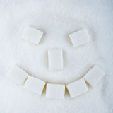 Sweet smile. From sugar cubes royalty free stock image