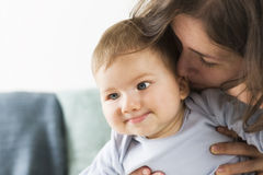 Sweet smiling baby boy laughing together with his mother. Royalty Free Stock Photo