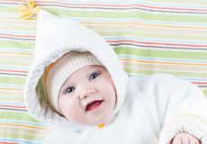 Sweet smiling baby in a funny hood Royalty Free Stock Images