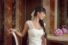 Sweet smiling. Lovely wedding details: bouquet and lace. Wedding ceremony Stock Image