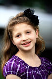 Sweet smiling young girl with hair bow. Stock Image