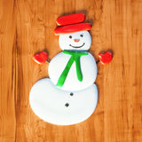 Sweet snowman candy Christmas gift on wooden table 3d render Stock Images