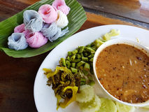 Sweet soup with colorful rice vermicelli on banana leaf and vege Stock Photos