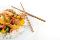 Sweet and Sour Chicken. With chopsticks on a white background Royalty Free Stock Image