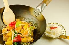 Sweet and sour chicken. Wok stir fry of sweet and sour chicken Royalty Free Stock Photography