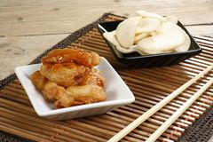 Sweet and sour chicken. Chinese sweet and sour chicken in batter with prawn crackers Stock Photo