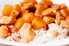 Sweet and sour chicken. With pineapple chunks over white rice Royalty Free Stock Image