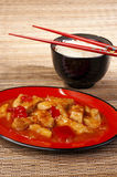 Sweet and sour chicken. Chinese sweet and sour chicken served with basmati rice Royalty Free Stock Photos