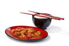 Sweet and sour chicken. Chinese sweet and sour chicken served with basmati rice Royalty Free Stock Photo