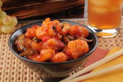 Sweet and sour chicken. A bowl of sweet and sour chicken with iced tea Stock Image