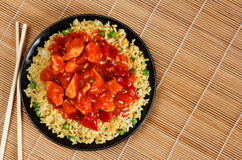 Sweet and sour chicken. With fried rice - popular oriental cuisine Stock Photos