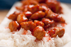 Sweet and sour chicken balls with rice. Sweet and sour sauce on chicken balls with rice Stock Photo
